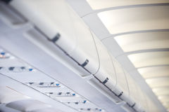 Interior de los aviones comerciales Imagen de archivo libre de regalías