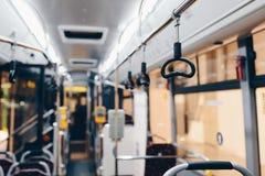 Interior de um ônibus moderno da cidade Imagem de Stock