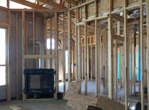 Interior de uma casa nova grande sob a construção Imagem de Stock