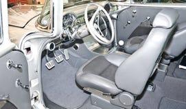 Interior de un coche clásico Foto de archivo libre de regalías