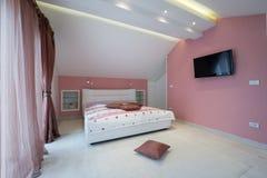 Interior de un dormitorio engañoso Fotos de archivo libres de regalías