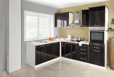 Interior de una cocina moderna, muebles de madera, simple y limpio Fotografía de archivo libre de regalías
