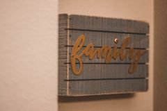 Interior Decor, Family Signage, Loving Home. Interior Decor, Gather Signage, Loving Home. with bokeh background. In home signs and statements for a happy home Stock Photo