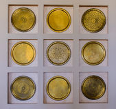 Interior decor of ornate round brass wall plates Royalty Free Stock Photos