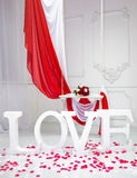 Interior decorated for Valentine's Day. Word love. White Swing royalty free stock photo