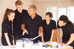 Interior decorating team in discussion Royalty Free Stock Photos