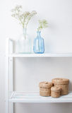 Interior decoration: branches in bottles and baskets Royalty Free Stock Photo