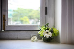 Interior decoration. A simple flower bouquet gives a refreshing feel to an otherwise empty room Stock Photography