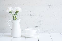 Interior with decorative vase and cup of tea on table top and wh Royalty Free Stock Image