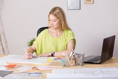 Interior decorator drawing new project Royalty Free Stock Images