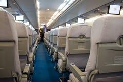 Interior del aeroplano con filas chear Foto de archivo libre de regalías