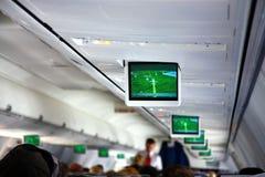 Interior del aeroplano con los telescreens Imagen de archivo