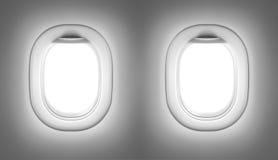 Interior del aeroplano o del jet con las ventanas Imagenes de archivo