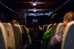 Interior del autobús con la gente foto de archivo libre de regalías