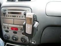 Interior del coche con el móvil Imagen de archivo libre de regalías