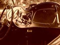 Interior del coche de deportes de la vendimia Foto de archivo