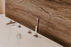 Interior del cuarto de baño con un grifo foto de archivo libre de regalías