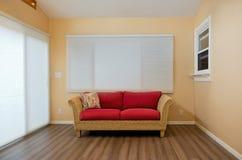 Interior del Sunroom con Loveseat Fotos de archivo