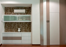 Interior design. Of a room with cabinet and hidden door Stock Photography
