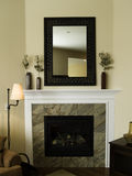 Interior Design. Fireplace and mantel with mirror Stock Photography
