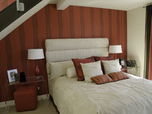 Interior Design. Loft Bedroom in red and white Stock Photography