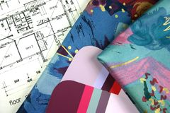 Interior Design. Samples of paint and curtain fabrics with house plan blueprint in background Royalty Free Stock Photography