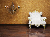 Interior design with an armchair and a chandelie Royalty Free Stock Photos