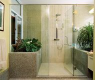 Interior design - bathroom. Master bathroom with pebbles wall Stock Photos