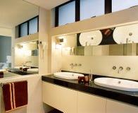 Interior design - bathroom. Master bathroom with mirror and basin Royalty Free Stock Image