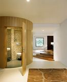 Interior design - bathroom. Bathroom with bended veneer featured wall Royalty Free Stock Photography