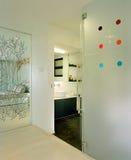 Interior design - bathroom. Master bathroom with graphical mirror Royalty Free Stock Photo