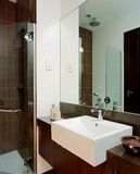 Interior design - bathroom. Common bathroom with mirror and tiles Royalty Free Stock Photos