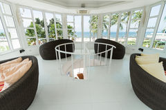 Interior design for beach viewing. White room and chair for nice sea view Stock Photos