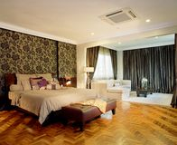 Interior design - bedroom. Master bedroom with family area Stock Photography