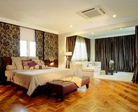 Interior design - bedroom. Master bedroom with family area Stock Photos
