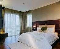 Interior design - bedroom. Master bedroom with king size bed Stock Image