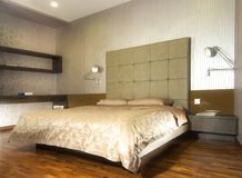 Interior design - bedroom. Master bedroom with leather bedhead Stock Photography