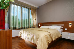 Interior design - bedroom. Master bedroom with day and night curtains Royalty Free Stock Photography