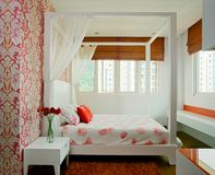 Interior design - bedroom. Girls bedroom with wallpaper and bed Royalty Free Stock Photos