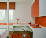 Interior design - bedroom. Boys bedroom with orange wall Stock Images