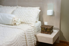 Interior design - bedroom. Master bedroom with bedside table Stock Photography