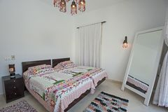 Interior design of bedroom in luxury holiday villa. Interior design decor furnishing of luxury show home holiday villa bedroom with furniture Royalty Free Stock Image