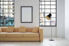 Interior design with blank frame. Interior design with beige sofa, blank picture frame, lamp and windows with city view. Mock up, 3D Render Stock Photography