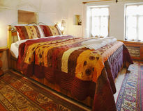 Interior design cave bedroom multi colored bedding royalty free stock images