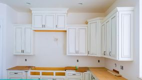 Interior design construction of a kitchen with cooker extractor Stock Photo