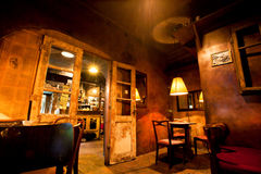 Interior design of cozy old cafe with wooden furniture, doors and lamps Royalty Free Stock Photography