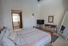 Interior design of bedroom in luxury holiday villa. Interior design decor furnishing of luxury show home holiday villa bedroom with furniture Stock Photos