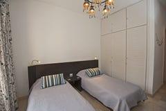Interior design of bedroom in luxury holiday villa. Interior design decor furnishing of luxury show home holiday villa bedroom with furniture stock photo