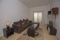 Interior design of an apartment living room show home. Interior design decor of a luxury modern apartment living room with furniture and sea view Stock Photos
