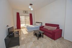 Interior design of a studio apartment living room show home. Interior design decor of a studio apartment living room with furniture and table Stock Images